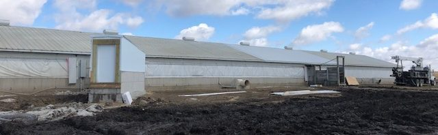 Aging hog barn that had more insulation blown into the attic by Kinzler Construction Services