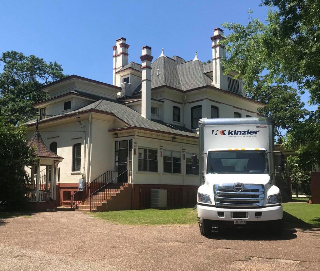 Kinzler using blown-in fiberglass insulation to insulate the home to increase energy efficiency with minimal disturbance to existing finishes of the historic home.