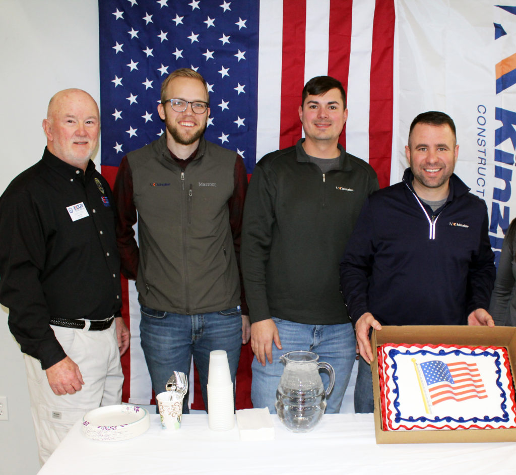 Kinzler honored employees called to be deployed & received the Patriot Award for support of the Guard & Reserves. Those honored posed in front of a cake at the ceremony.